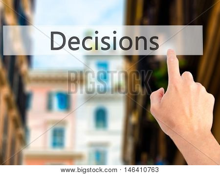 Decisions - Hand Pressing A Button On Blurred Background Concept On Visual Screen.