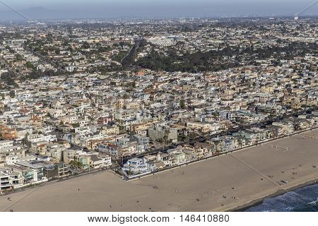 Hermosa Beach, California, USA - August 16, 2016:  Afternoon aerial view of coastal Hermosa Beach and Manhattan Beach communities in Southern California.