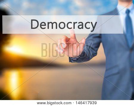 Democracy -  Businessman Press On Digital Screen.
