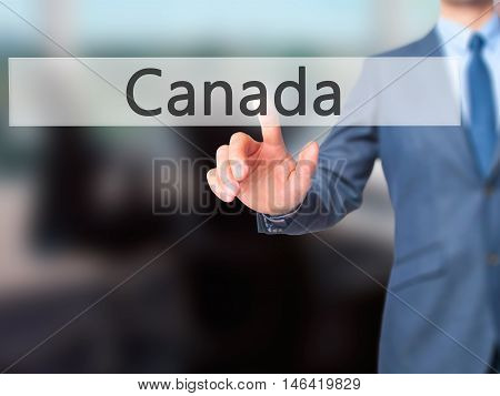 Canada -  Businessman Press On Digital Screen.