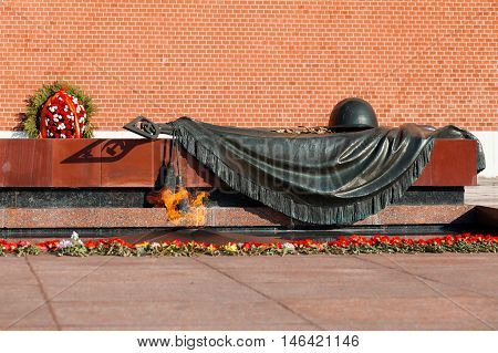MOSCOW, RUSSIA - SEPTEMBER 02, 2016: Tomb of Unknown soldier and Eternal flame in Alexander garden near Kremlin wall in Moscow Russia