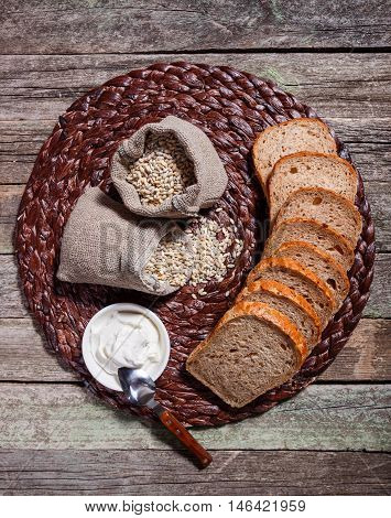 Wholewheat Bread With Cream Cheese On The Plate On Rustic Wooden Background. Top View