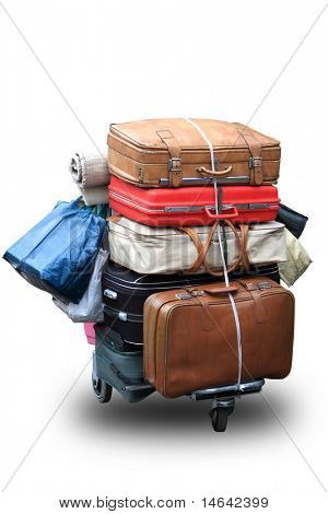 Many old suitcases on a cart