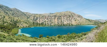 Panoramic view. Color water of lake Kournas at Crete island in Greece.