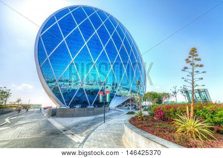 ABU DHABI, UAE - MARCH 27: Aldar headquarters building on March 27, 2014, UAE. Aldar headquarters is world first circular building, high for 110m with 61,900 m2 (666,000 sq ft) of floor area.