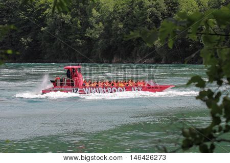 NIAGARA FALLS, CANADA- JULY 15, 2016 The Whirlpool Jet Boat Tours start from Niagara-on-the-Lake and head into the river's current to reach the gorge and the rapids. It is a large jet boat that gives you an exhilarating journey.