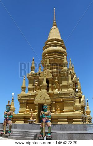 SURAT THANI, THAILAND - MAY 2015 : Giants statue guarding Golden Laem Sor Pagoda, in Ban Lamai, Ko Samui District, Surat Thani province in Thailand on May 28, 2015