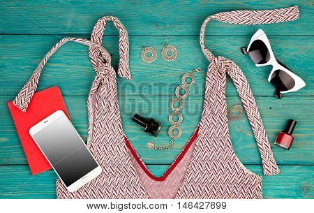 Voyage Concept - Set Of Woman Stuff With Dress, Smart Phone, Notepad, Accessory And Nail Polishes On
