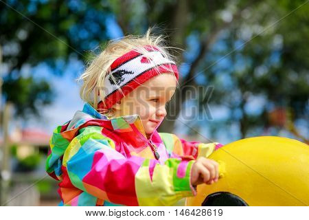 Attractive little girl on outdoor playground equipment Dunedin New Zealand