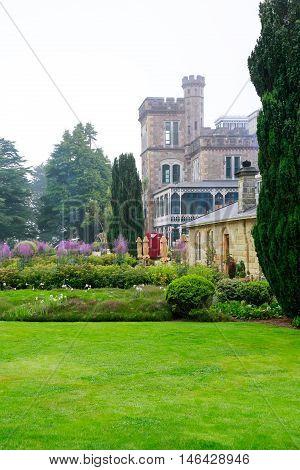 Dunedin, New Zealand - Febr 10, 2015: Foggy Morning In The Garden Of Larnach Castle