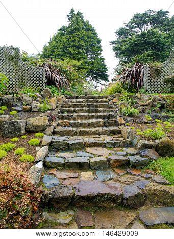 Dunedin, New Zealand - Febr 10, 2015: Stone Steps In A Peaceful   Garden Of Larnach Castle