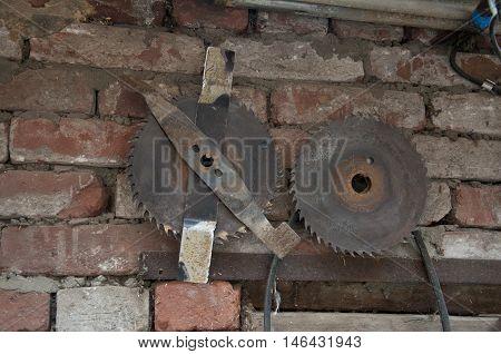 used a circular saw on a shabby brick wall