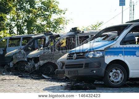 MAGDEBURG, GERMANY - SEPTEMBER 08, 2016: Burnt-out cars after an arson attack on police cars in the center of Magdeburg on 08.September 2016. 18 cars burned in this attack