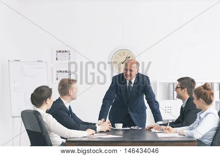Corporate Meeting With A Relaxed Boss