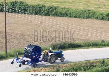 The tractor on the road