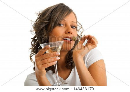 Young woman drinking martini isolated on white background. Waist up view horizontal shot
