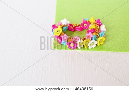 Childrens bracelet. Bracelet with plastic flowers. Bright childrens bracelet