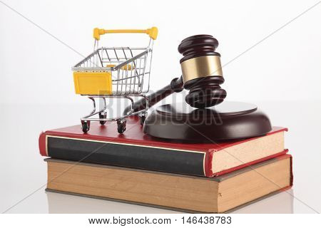 gavel hammer and a shopping cart on the white background