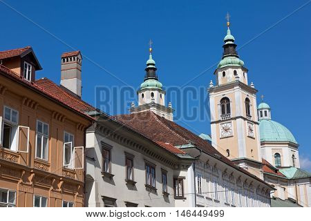Ljubljana, Slovenia, St. Nicholas cathedral steeples with clock