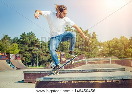 Skater Jumping In Skateboard Park