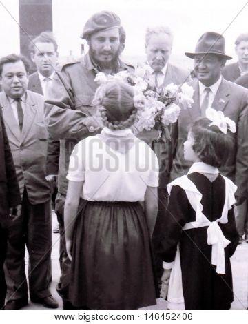 Yangiyer Uzbekistan - May 10 1963: Pioneer girls are meeting Fidel Castro.