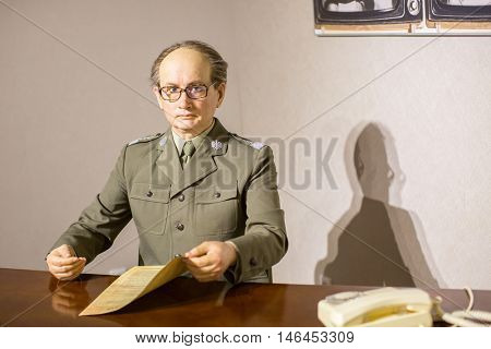 KRAKOW, POLAND - FEB 9, 2016: Wojciech Jaruzelski wax figure of Polonia Wax Museum at Main Market Square. The Wax Museum was opened in 2016, inspired by the organization in Krakow World Youth Day.