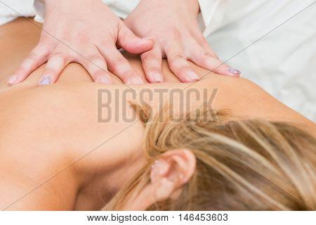 Back massage in massage parlour, color image