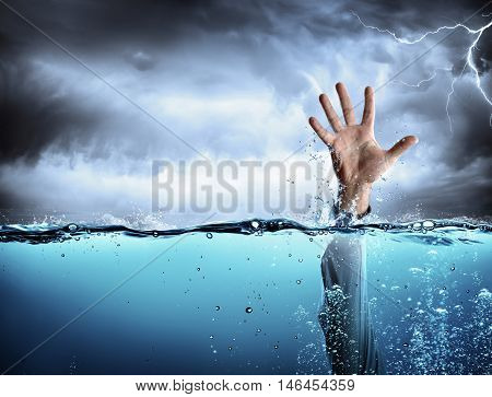 Help Concept - Drowning And Failure - Man's Hand In Sea