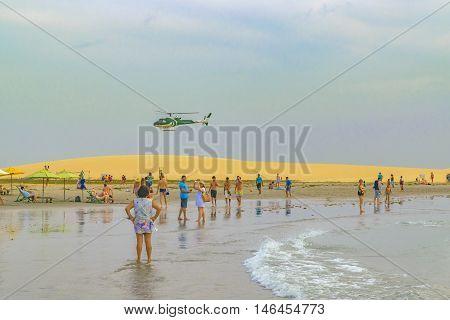 JERICOACOARA, BRAZIL, DECEMBER - 2015 - People at the main beach of Jericoacoara in Brazil