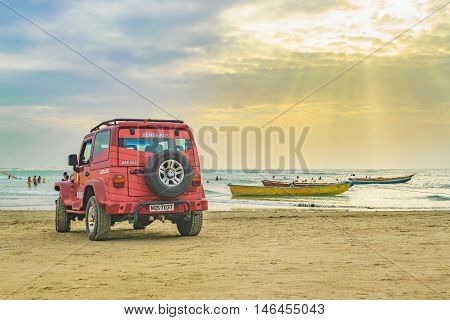 JERICOACOARA, BRAZIL, DECEMBER - 2015 - 4x4 truck and boats at the most famous beach of Jericoacoara in Brazil