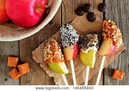 Sweet Chocolate And Caramel Dipped Apple Slices, Scene On A Rustic Wooden Background