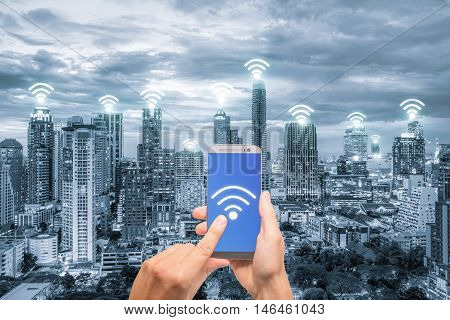 Hand holding mobile phone with wifi network connection network. Wifi network connection concept.