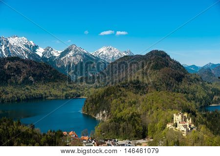 Castle Hohenschwangau with lake and europe alps in background at Munich Germany.