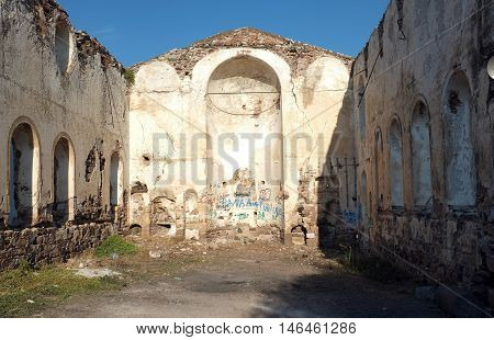 Historic church ruins with no roof in Cunda Island, Turkey
