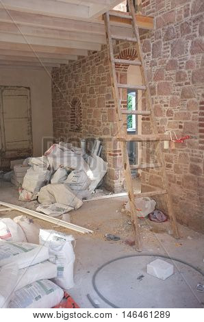 Interior construction with cement bags and ladder