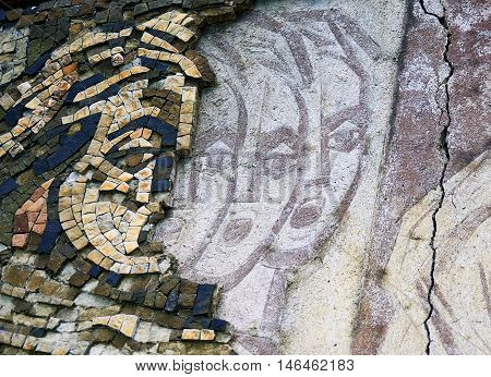 GABROVO BULGARIA - JULY 20 2016: Fragment of abstract mosaic art of abadoned Comunistical monument in Buzludza Bulgaria.