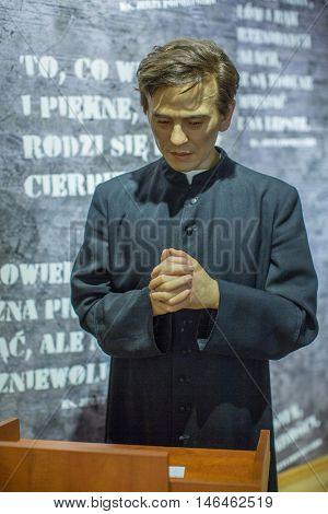 KRAKOW, POLAND - FEB 9, 2016: Jerzy Popieluszko (Polish Roman Catholic priest, Martyr of the Catholic Church) wax figure of Polonia Wax Museum at Main Market Square.