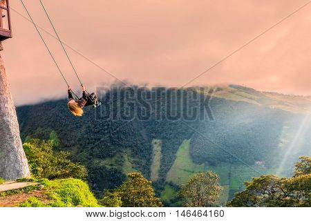 Banos Ecuador - 30 march 2015: The Swing At The End Of The World Located At Casa Del Arbol The Tree House In Banos De Aqua Santa Ecuador South America