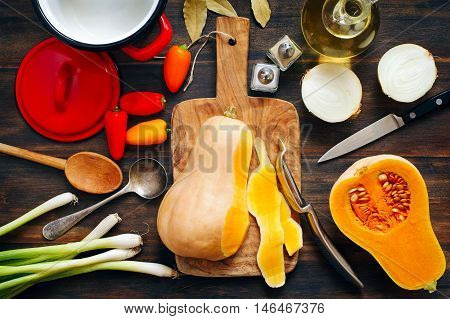 Preparing pumpkin, onions and sweet peppers for cooking