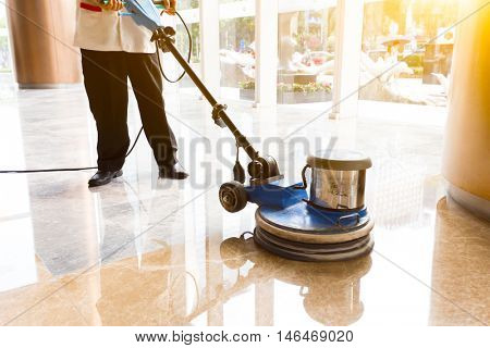 people polishes floor indoors