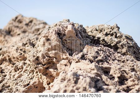 Blurry View of Rocks and Blue Sky