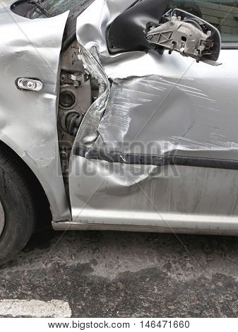 Crushed Door Damage at Silver Car After Accident