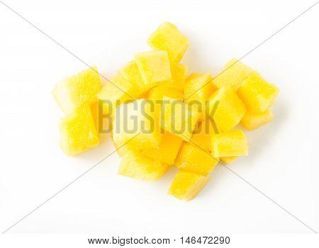 Mango slice cut to cubes isolated on white background