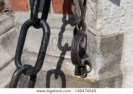 Old shackles in the wall of the St. Mary's Basilica. Krakow. Poland.