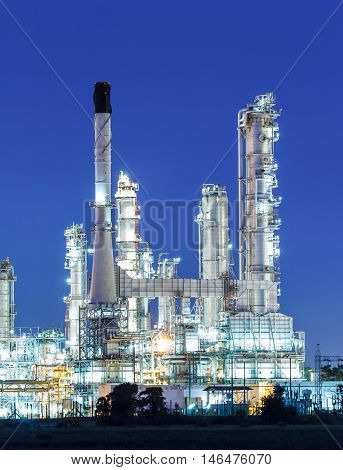 The Oil refinery plant at twilight dark blue sk.