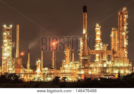 The Oil refinery plant at twilight dark.
