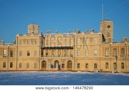 GATCHINA, RUSSIA - JANUARY 22, 2016: The facade of the Big Gatchina Palace closeup in the rays of the setting sun on a january evening. Historical landmark of the city Gatchina