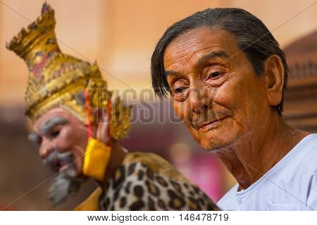 Bangkok Thailand - January 16 2016: Waxwork of Mr. Sakorn Yankeosod (A.K.A. Joe Louis) the master of thai traditional puppet displayed in the occasion of celebrating H.R.H. Princess Sirindhorn's birthday