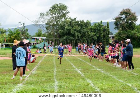 PHITSANULOK THAILAND - SEP 1: Compete on 100 Meter Dash Final for children on Sep 1 2016 at chumchon wat bandong school in Phitsanulok Thailand