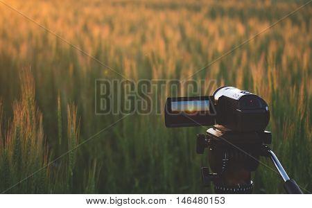 Video camera on a tripod at sunset